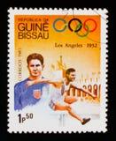 Transenna-corsa, serie dei giochi olimpici, circa 1983 Fotografia Stock Libera da Diritti