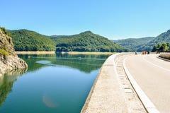 The Lake Vidradu. Transfagaras road, Romania, - August 3, 2017: Tourists near the dam and lake Vidradu stock photos