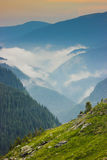Transfagarasan area landscape, Romania. Panoramic view Fagaras Mountains with fog and low level clouds around  Transfagarasan road in Romania with partly cloudy Stock Images
