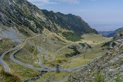 Transfagarasan - High altitude winding road in Carpathians mountains panorama. Aerial view. Stock Photos