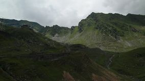 Transfagarasan highway on a cloudy day. Mountain near Transfagarasan highway with clouds over it stock video footage