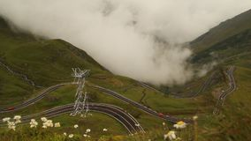 TRANSFAGARASAN HIGHWAY WITH HUGE TRAFFIC. AND FOG COMING TOWARDS CAMERA stock footage