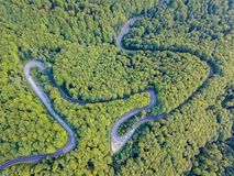 Transfagarasan road DN7C in regions of Transylvania and Wallachia. Winding asphalt paved road in woods of Carpathians, Romania. royalty free stock image