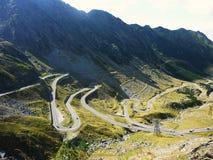 Beautiful winding mountain road on Transfagarasan in Romania. Transfagarasan is one of the most spectacular mountain roads in the world Stock Photos