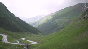 Transfagarasan pass in summer. Crossing Carpathian mountains in Romania, Transfagarasan is one of the most spectacular mountain ro. Ads stock footage