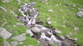 Mountain rivers and waterfalls in Transfagarasan pass at summer. Carpathian mountains in Romania, Transfagarasan is one of the mos. Transfagarasan pass in summer stock video footage