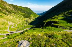 Transfagarasan road in mountains of Romania. Gorgeous view of the landscape from the edge of a hill. serpentine road with is winding down the valley stock images