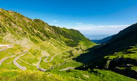 Transfagarasan road in mountains of Romania. Gorgeous view of the landscape from the edge of a hill. serpentine road with lots of turnarounds is winding down stock images