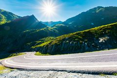 Transfagarasan road in mountains winding uphill. Popular travel destination of Romania. beautiful summertime weather royalty free stock photo