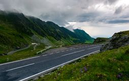 Transfagarasan road on a rainy day. Dangerous driving concept. view from the side of the road royalty free stock photos