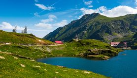 Lake Balea in Fagaras mountains on a bright sunny day. Transfagarasan road, Romania - Jun 26, 2017: lake Balea in Fagaras mountains on a bright sunny day stock photo