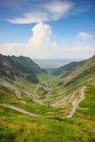 Transfagarasan road, Romania. Panoramic view of Transfagarasan road in Romania with partly cloudy blue sky background Stock Photos