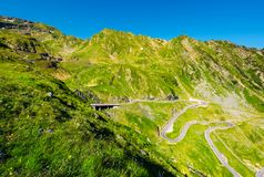 Transfagarasan road serpentine in the valley. Beautiful transportation scenery in mountains of Romania. location southern Carpathians Royalty Free Stock Images