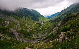 Transfagarasan road on a stormy summer day. Transfagarasan road in Southern Carpathians on a stormy summer day. beautiful landscape with gloomy sky in Fagaras Stock Photos