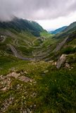 Transfagarasan road on a stormy summer day. Transfagarasan road in Southern Carpathians on a stormy summer day. beautiful landscape with gloomy sky in Fagaras stock images