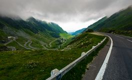 Transfagarasan road in stormy weather. Dangerous driving concept. view from the side of the road stock images