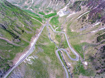 Transfagarasan Romania curved road trough the mountains. Aerial stock images