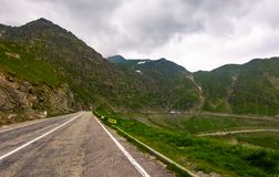 Transfagarasan route in stormy weather condition. Lovely transportation scenery of legendary road in Romanian mountains royalty free stock photos