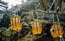 With the transfer of the cable car. Slowly rising operation of the cable car with a rope and with lower power wheels and gears Stock Photography
