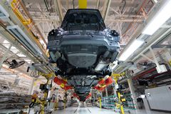 Transfer of car body bottom view. Robotic equipment makes the Assembly of car. Modern car Assembly at factory. Automated car Assembly line. plant of automotive royalty free stock images