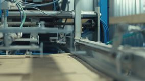 Transfer of cardboard to the machine for the production of cardboard boxes stock footage