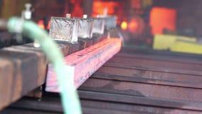 Transfer fiery steel blocks. Detail view of Steel making - transfer fiery steel blocks stock video