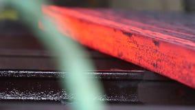 Transfer fiery steel blocks. Detail view of Steel making - transfer fiery steel blocks stock footage