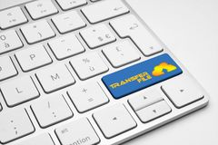 Transfer file blue button with a cloud icon on a keyboard. Transfer file blue button with a cloud icon on a white isolated keyboard stock image
