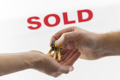 Transfer of keys with sold in background Stock Photo
