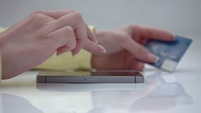 Transfer of money from card to card. Ordering via phone. payment via credit card online stock footage