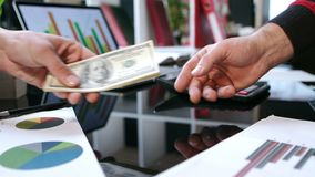 Transfer money cash from hand to hand. Business handshake after money deal stock footage