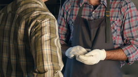 Transfer money one worker to another in workshop.Hands. stock footage