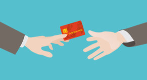 Transfer of the red credit card from hand to hand Stock Photos