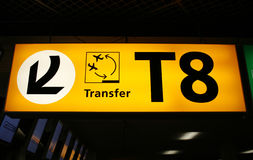 Transfer sign. Yellow airport sign wich indicates gate number and direction for transfer Royalty Free Stock Photography
