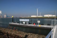 Transferium for waterbus in the Maasvlakte harbor in Rotterdam the Netherlands, workers of factories will come by ship and. Transfer to busses in the very wide stock photo