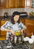 Transferring Cooked Winter Melon from Cooking Pot to Dinner Plat Royalty Free Stock Photos
