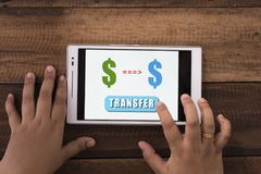 Transferring money online Stock Photo
