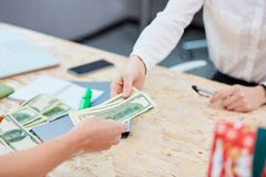 Transfer of money from hand to hand on the background of the table royalty free stock images