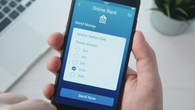 Transferring money using banking app. Stock footage stock footage