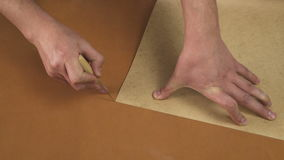 Transferring template to leather. stock footage