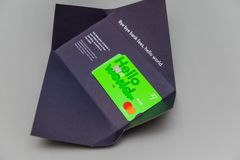 TransferWise Borderless Account multi-currencies Mastercard debit card. Paris, France - Mar 14, 2018: Man hand unboxing new TransferWise Borderless Account multi stock photo