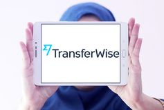 TransferWise money transfer service logo. Logo of TransferWise company on samsung tablet holded by arab muslim woman. TransferWise is an Estonian developed and royalty free stock photography