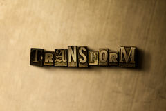 TRANSFORM - close-up of grungy vintage typeset word on metal backdrop. Royalty free stock - 3D rendered stock image.  Can be used for online banner ads and Stock Image