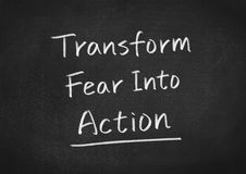 Transform fear into action. Concept text on blackboard background Royalty Free Stock Photos