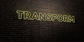 TRANSFORM -Realistic Neon Sign on Brick Wall background - 3D rendered royalty free stock image. Can be used for online banner ads and direct mailers Royalty Free Stock Image