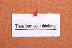 Transform your thinking. Text paper is pinned on cork stock photo