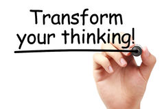 Transform your thinking. Text is written on transparent white board by hand with marker isolated stock photo