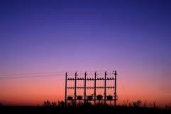 Transformadores de la puesta del sol Fotografía de archivo