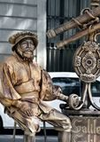 Transformation of man into monument or popular movie character. Barcelona, Spain - October 9, 2017: Trendy entertainment, transformation of man into monument or Royalty Free Stock Images