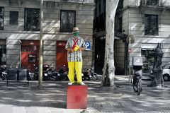 Transformation of man into monument or popular movie character. Barcelona, Spain - October 9, 2017: Trendy entertainment, transformation of man into monument or Stock Image